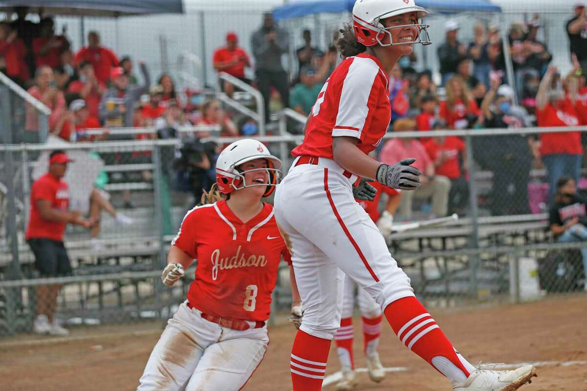 Judson Keely Williams #10 and Judson Madalynne Thornton #8 celebrate after scoring against O'Connor. Game 2 softball regional semifinal Judson vs. O'Connor on 5.22,.2021 at Judson HS