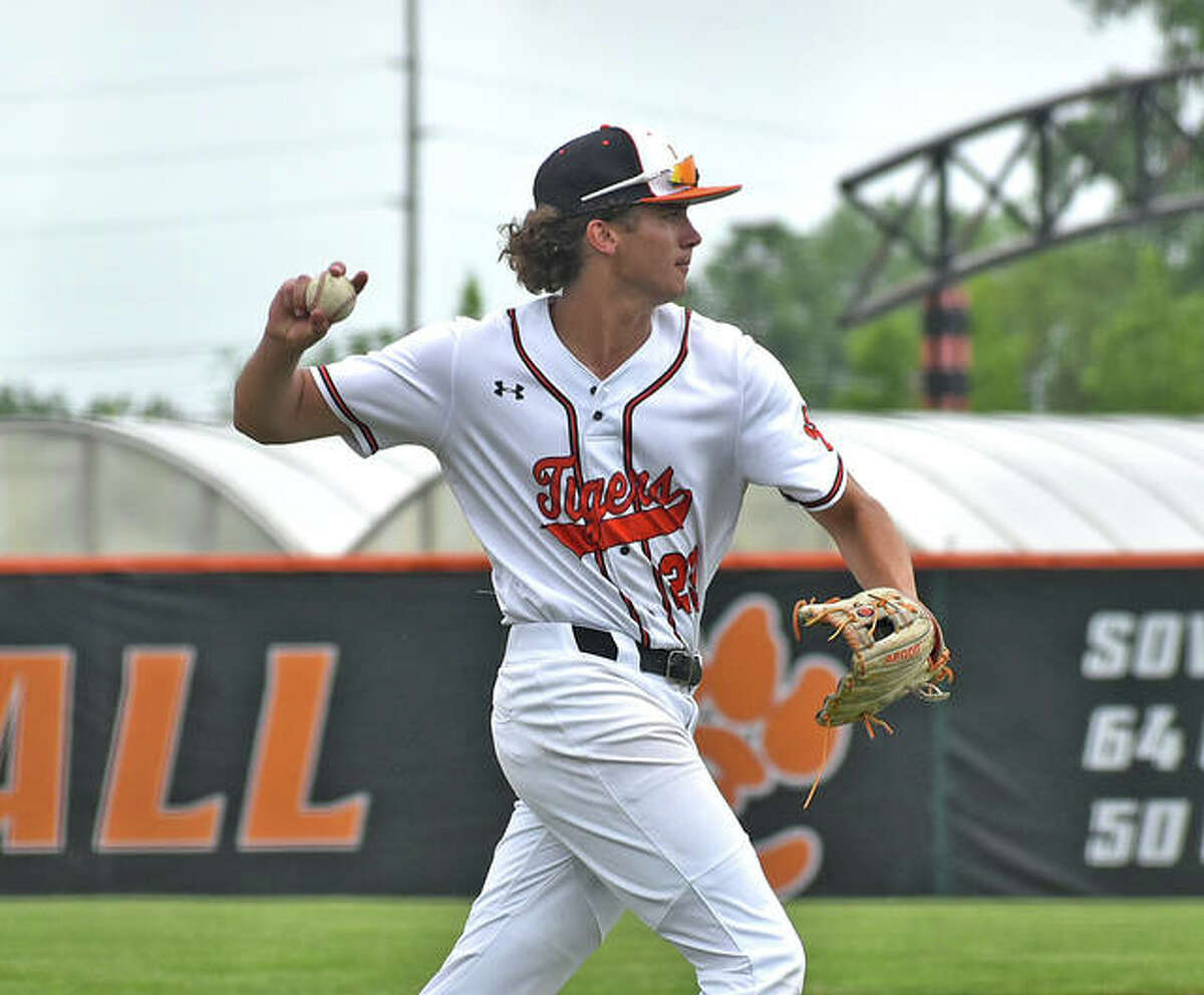Edwardsville third baseman Spencer Stearns fires a throw over to first base for a seventh-inning out against Nashville on Saturday at Tom Pile Field.
