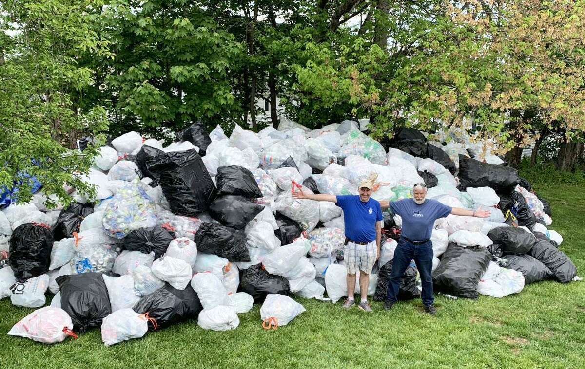 Members of the Middletown Kiwanis Club and Cans 4 a Cause Founder Jeff Myjak, right, collected between 100,000 and 125,000 bottles and cans worth an estimated $5,500 during a May 15 fundraiser for Warm the Children at Pat Kidney Field. At left is Public Works Deputy Director Chris Holden.