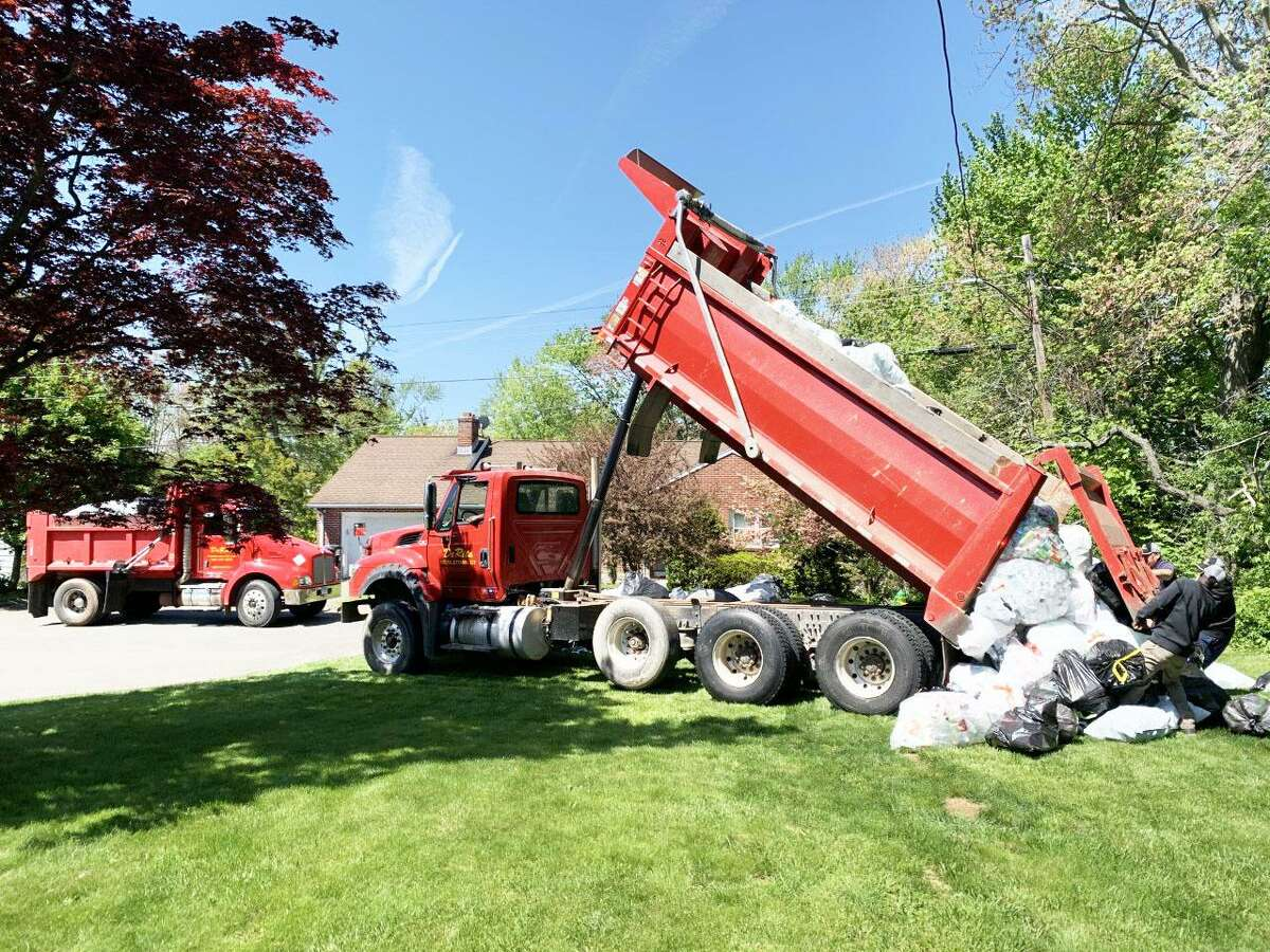 It took three trips for six dump trucks and an emergency operations trailer to haul bottles and cans to Cans-4-a-Cause Founder Jeff Myjak's house, where they began the expected two-week-long sorting process Thursday in Middletown.