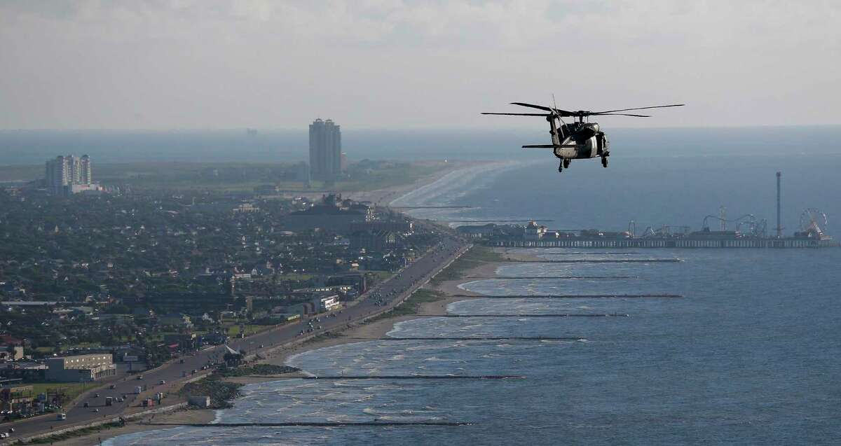 An Army Black Hawk helicopter, carrying U.S. Army Corps of Engineers officials, flies over Galveston while looking at FEMA Debris Sites, temporary housing and rehabilitation considerations while on a tour of the Corps current and proposed projects Wednesday, September 7, 2016. A dike, called the