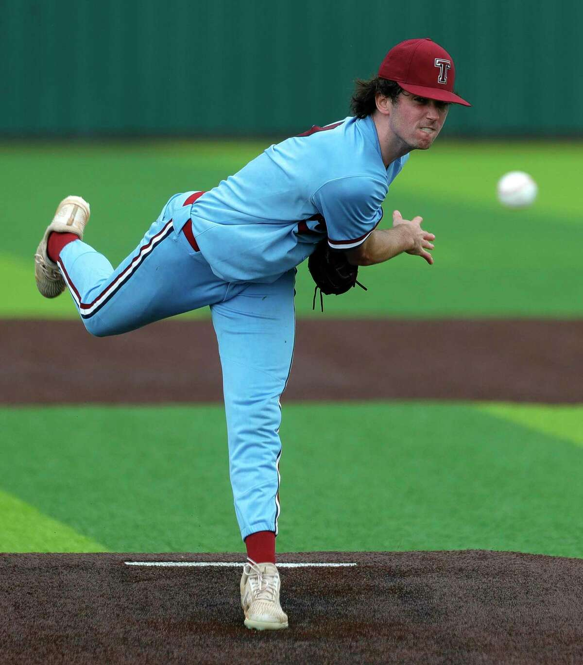 Katy Tompkins starting pitcher Michael DeBattista (7) throws in the first inning during Game 3 of a Region II-6A high school baseball quarterfinal series at Tomball Memorial High School, Saturday, May 22, 2021, in Tomball.