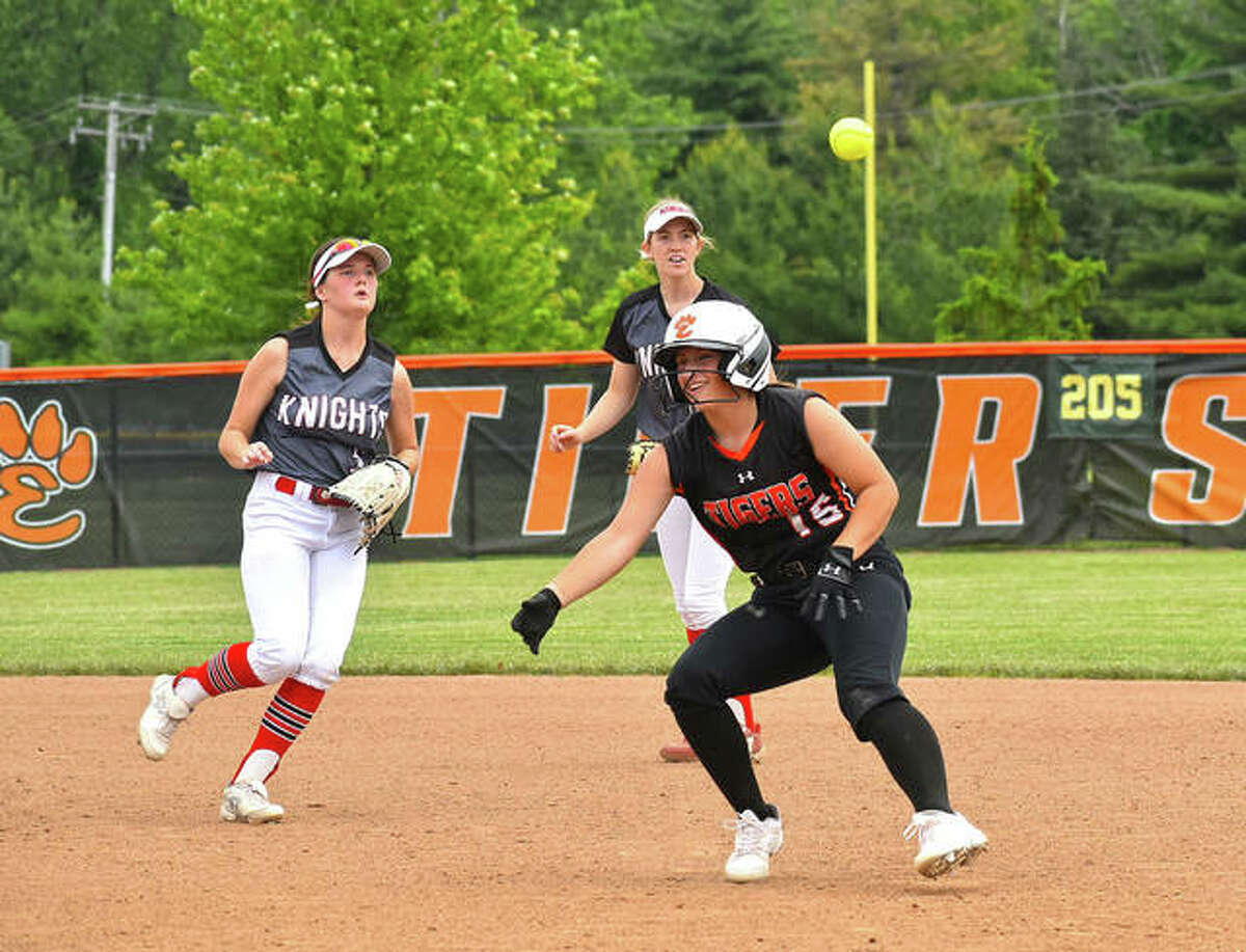 Edwardsville's Sydney Lawrence gets into a pickle between first base and second base against Triad during Saturday's game inside the District 7 Sports Complex. A run scored on the play.