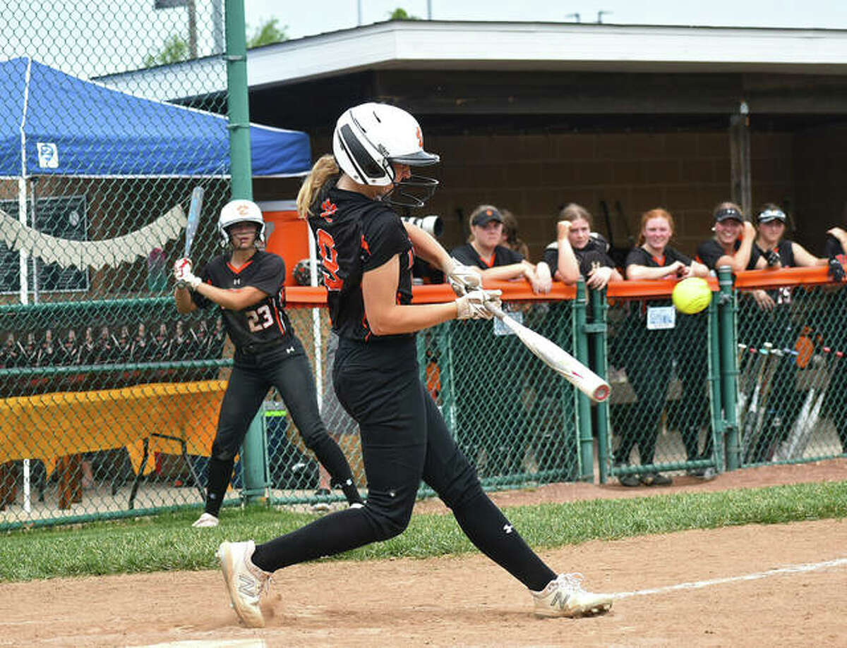 Edwardsville's Avery Hamilton hits a two-run single during Saturday's game inside the District 7 Sports Complex.
