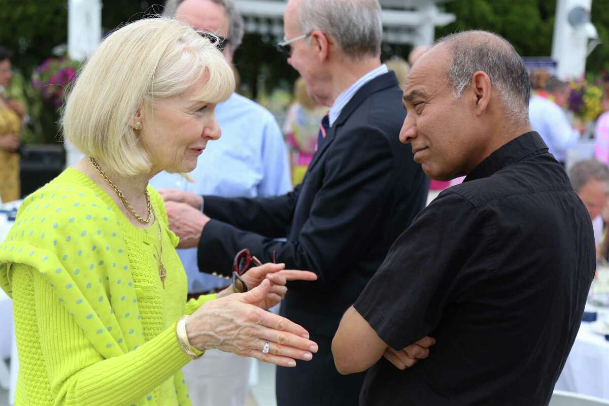 Colleen Charlesworth of Westport chats with Father Udayakumar Xavariapitchai of St. Luke Church in Westport at the Hope Blossoms spring brunch Caroline House event at The Inn at Longshore on Saturday, May 22, 2021.