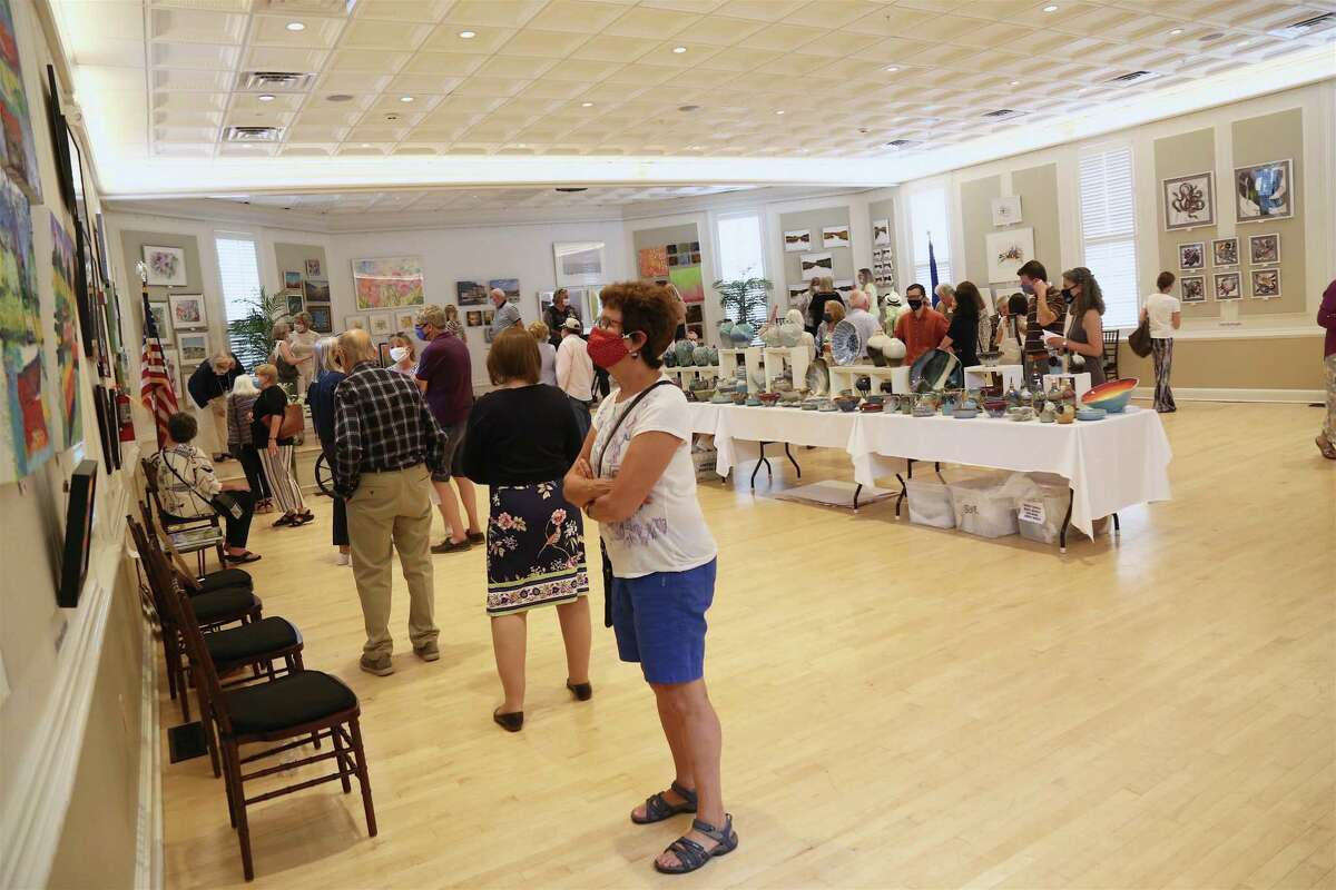 People were happy to be back inside at the Westport Woman's Club's annual art show on Saturday, May 22, 2021.