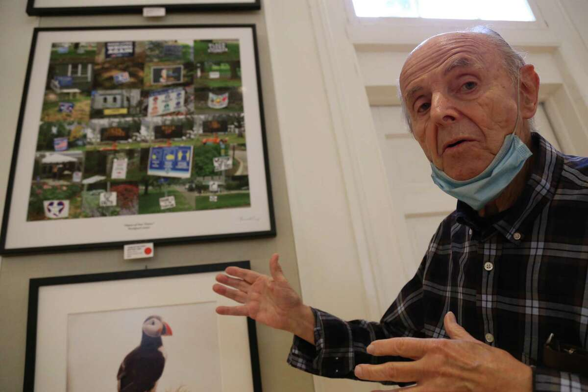Westport photographer Bernie Perry talks about his work at the Westport Woman's Club's annual art show on Saturday, May 22, 2021.