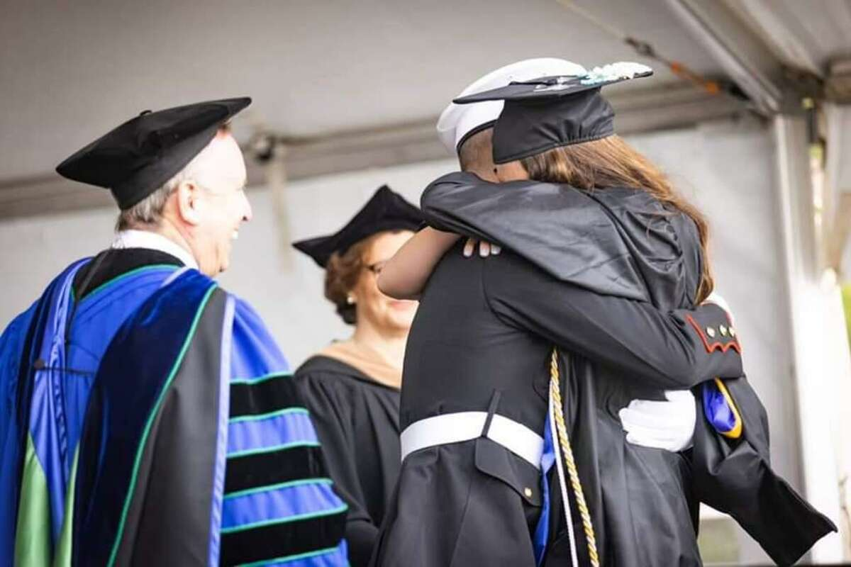 Ryan Booth surprises sister Emily Booth at her graduation