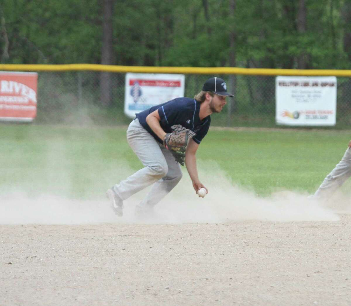 Brethren senior Skylar Wojciechowski scoops up a grounder during the Bobcats' sweep of Pentwater on Friday. (Dylan Savela/News Advocate)