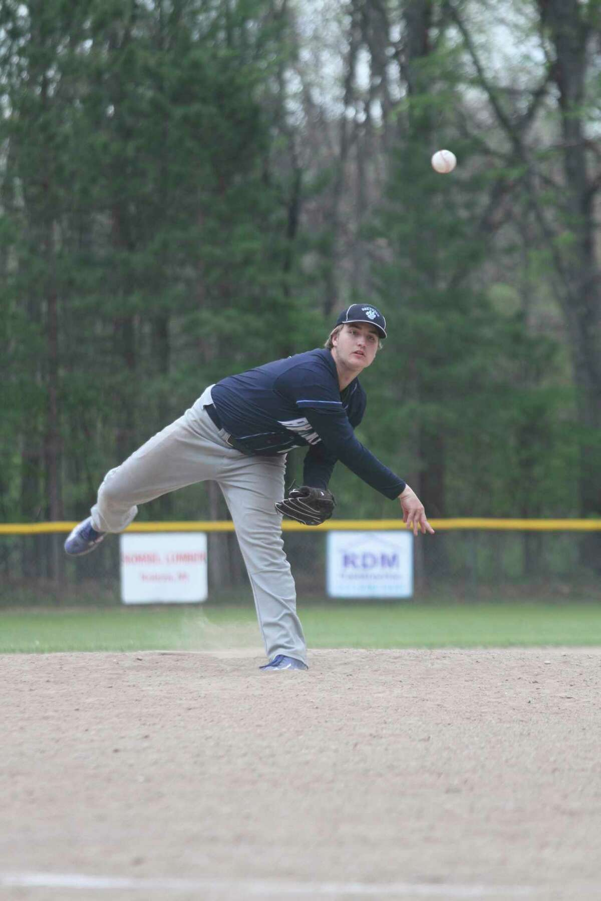 Brethren's Ethan Dean delivers a pitch during the Bobcats' home finale on Friday. (Dylan Savela/News Advocate)