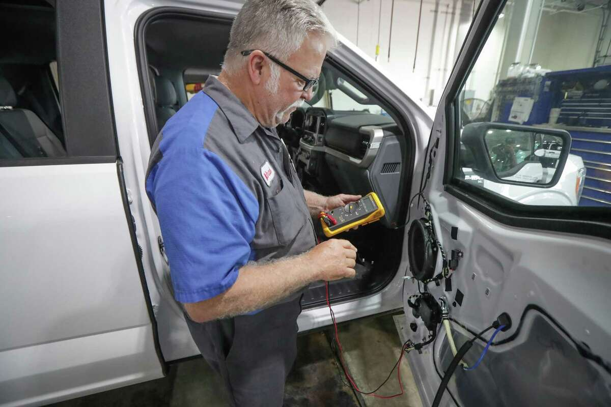 Tommie Vaughn Ford Senior Master Technician, Michael Lamb checks a low voltage module in a 2021 Ford F-150 truck Friday, May 21, 2021, in Houston. The dealership and others have been affected by a shortage in microchips supply chain issues.