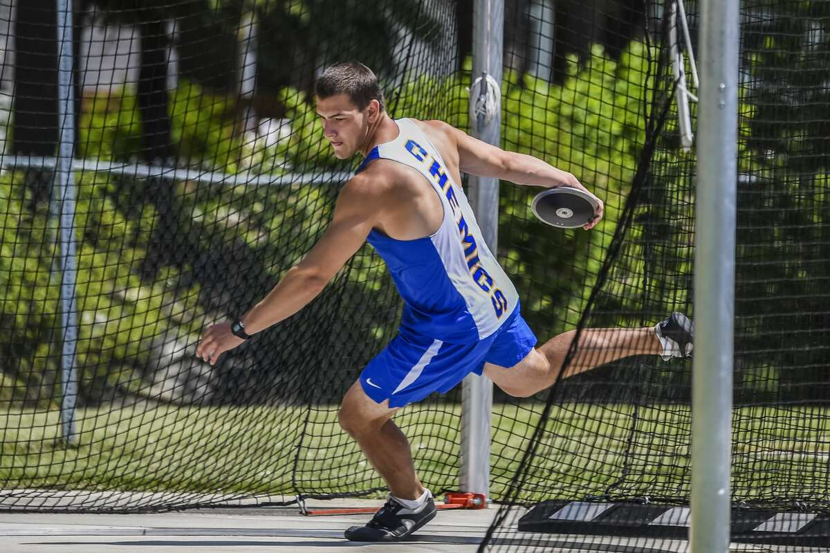 Midland High's Nolan Berg competes in the discus on May 15, 2021.