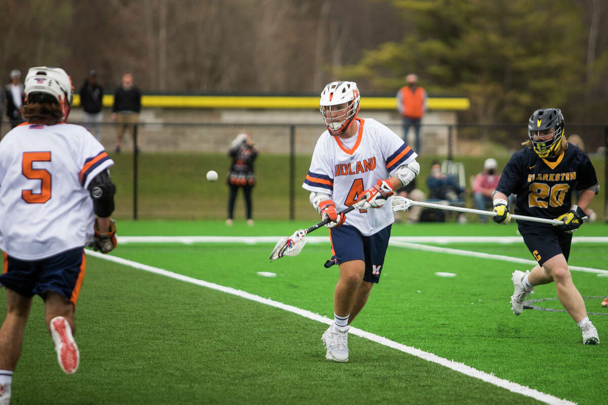 Midland-Dow's Ryan Stadelmaier (4) passes the ball during an April 9, 2021 game against Clarkston.