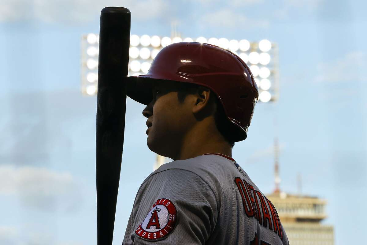 Los Angeles Angels' Shohei Ohtani waits on deck during the first inning of the team's baseball game against the Boston Red Sox on Friday, May 14, 2021, at Fenway Park in Boston. (AP Photo/Winslow Townson)