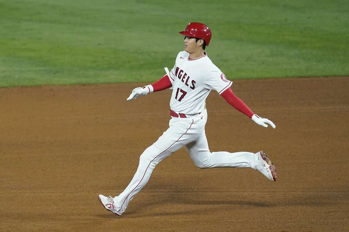 Los Angeles Angels designated hitter Shohei Ohtani (17) doubles during the sixth inning of a baseball game against the Oakland Athletics Saturday, May 22, 2021, in Anaheim, Calif. (AP Photo/Ashley Landis)