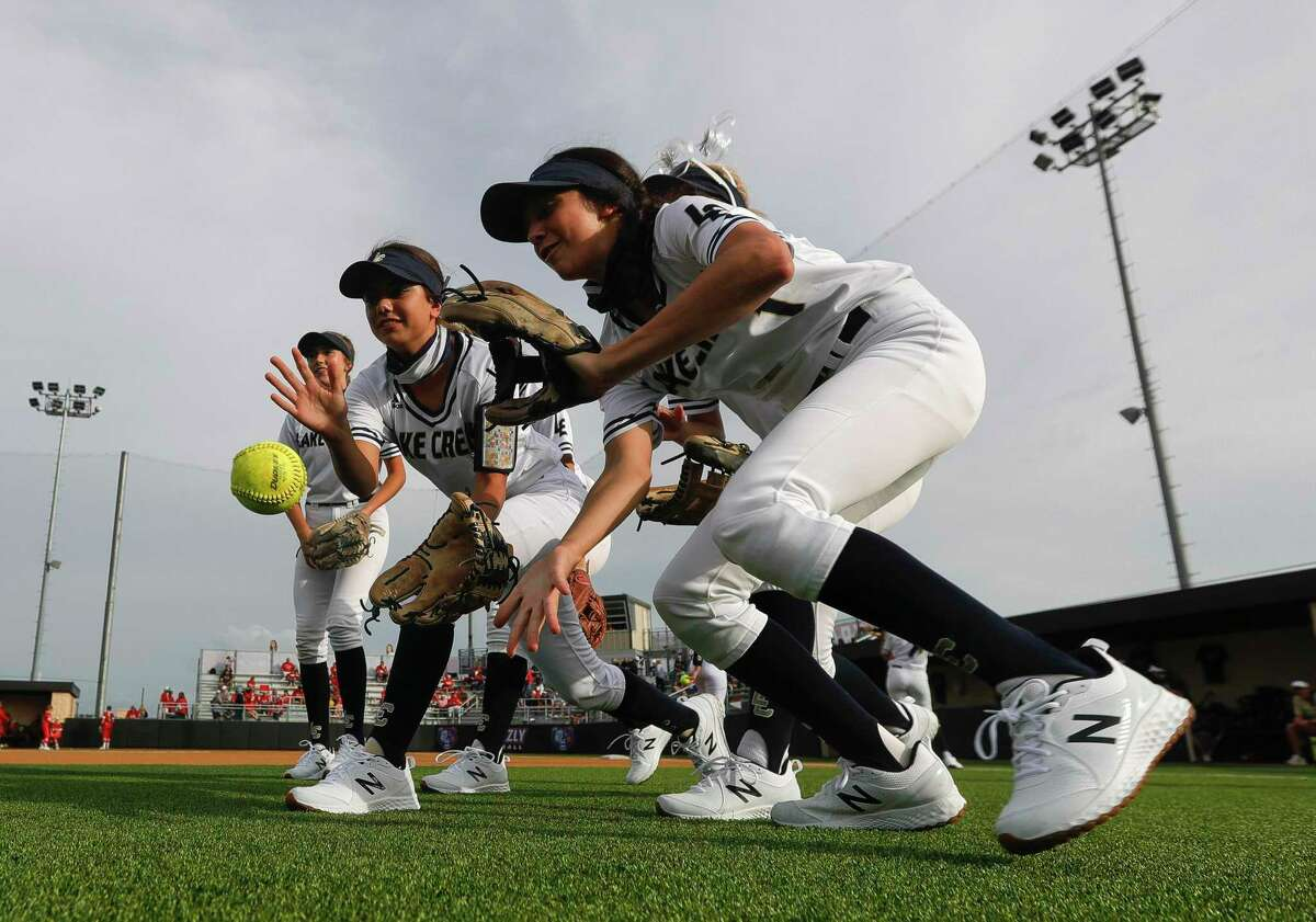Lake Creek players play a game before a one-game Region III-5A semifinal at Grand Oak High School, Thursday, May 20, 2021, in Spring.
