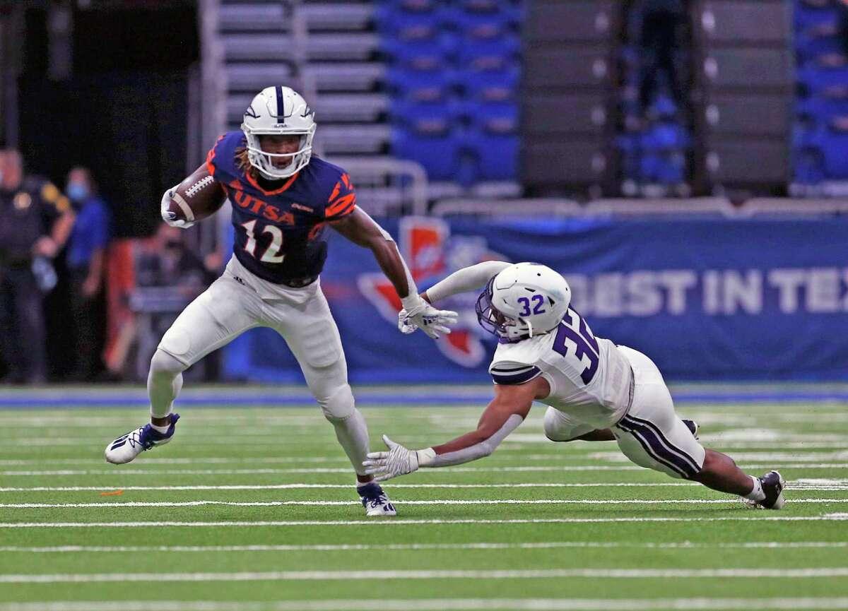 UTSA receiver Joshua Cephus avoids the tackle of Stephen F. Austin safety Myles Heard at the Alamodome on Saturday, Sept. 19, 2020.