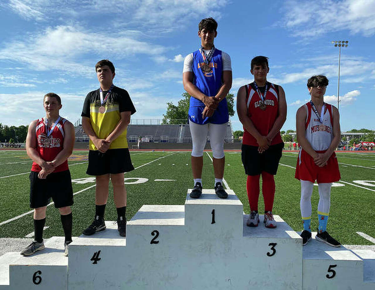 Lincoln's Iose Epenesa receives his first-place medal Saturday at the Illinois Junior High Elite Invitational. Epenesa won both the shot put and discus at the eighth-grade level.