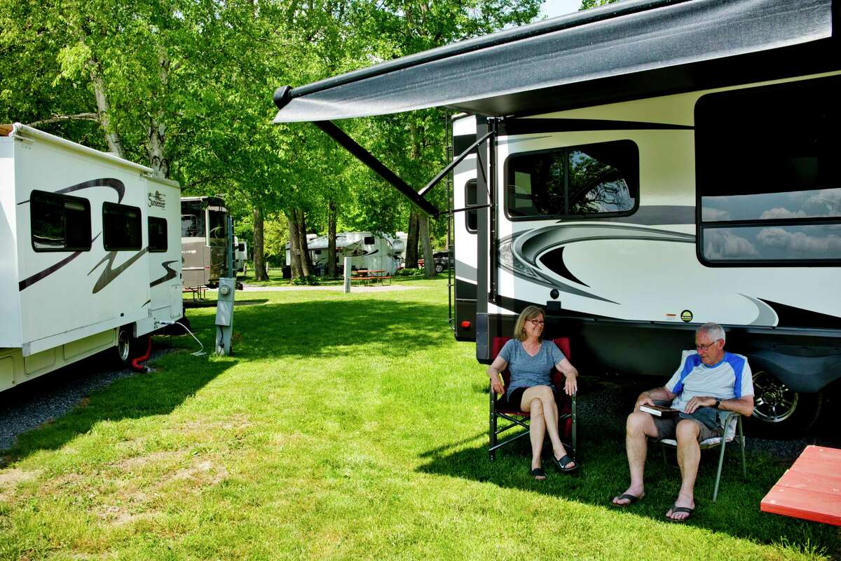 Susan LaTant and her husband, Lance LaTant of Queensbury relax outside their fifth wheel RV at Arrowhead Marina and RV Park on Sunday, May 23, 2021, in Glenville, N.Y. (Paul Buckowski/Times Union)
