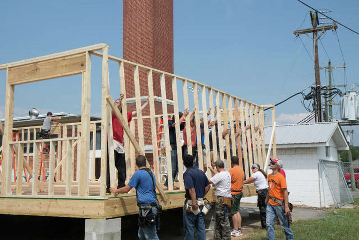 Volunteers help construct a Habitat For Humanity home. The Edwardsville/Glen Carbon chapter of Habitat For Humanity will host home ownership orientations to find a prospective area family to inhabit their own home.
