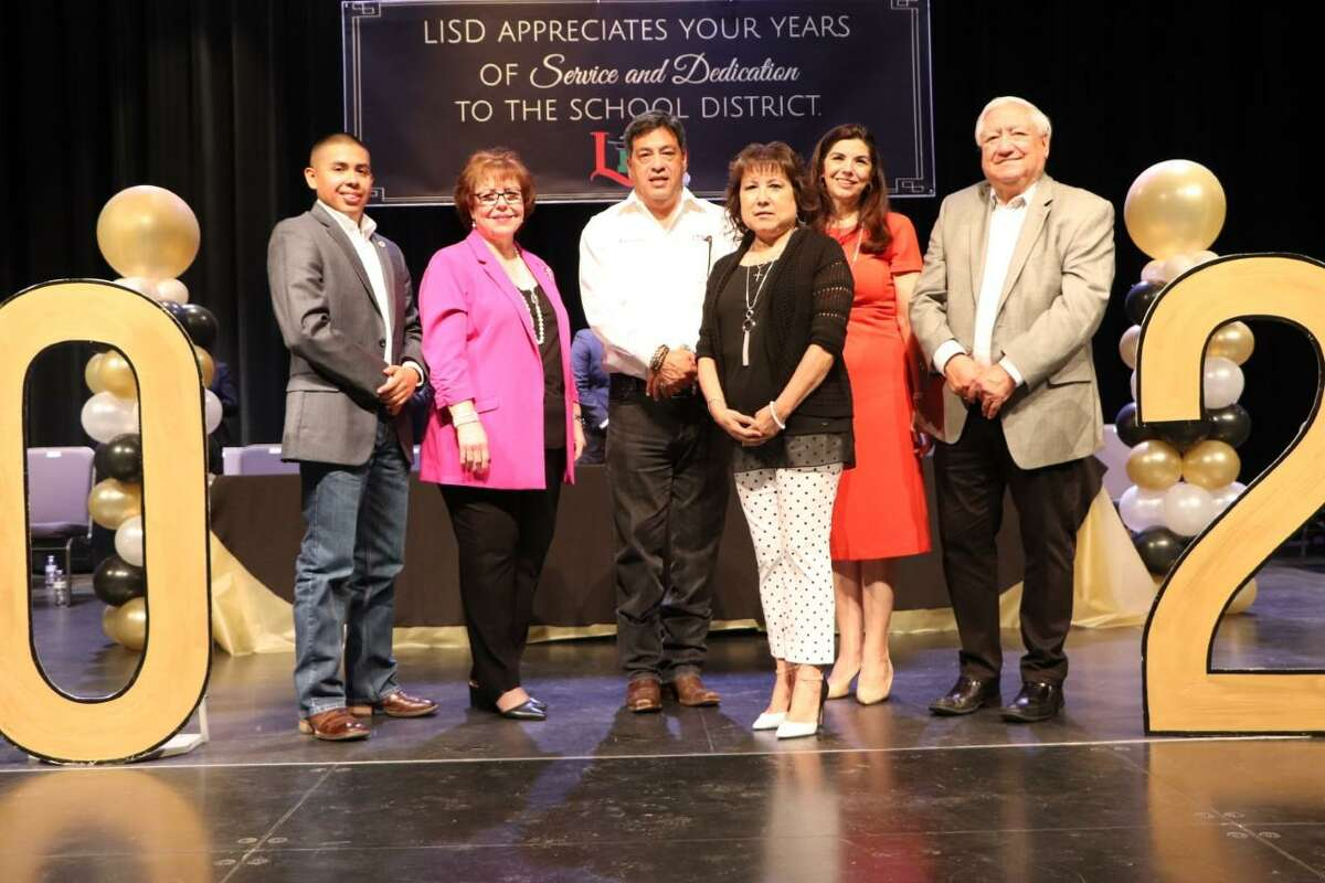 Belinda Casarez, LISD child nutrition program secretary, is thanked by LISD Board of Trustees member and Superintendent of Schools Dr. Sylvia G. Rios for her 48 years of service to school district. Pictured from left are LISD Board Member Guadalupe Gomez, Rios, LISD Board President Hector