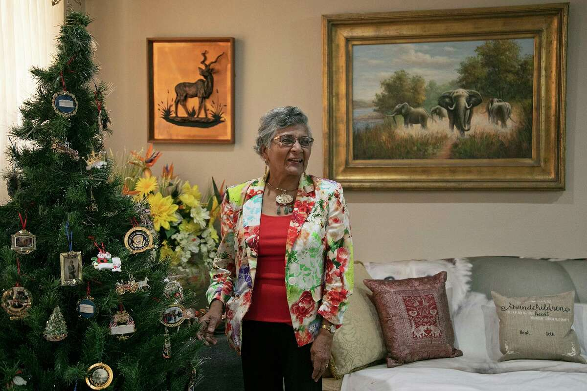 Army veteran Dr. Cecily David stands next to her Christmas tree at her home in San Antonio on May 20, 2021. David's home is decorated with mementos from her work and travels around the world, including her childhood in Tanzania.