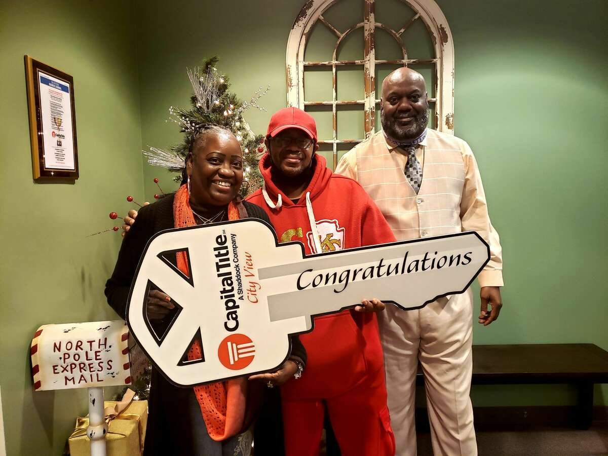 San Antonio residents Veda (from left) and David Reddic closed on their home on New Year's Eve. Their REALTOR, Mike Franklin, introduced the couple to a lender who advised them on how to quickly resolve their credit issues.