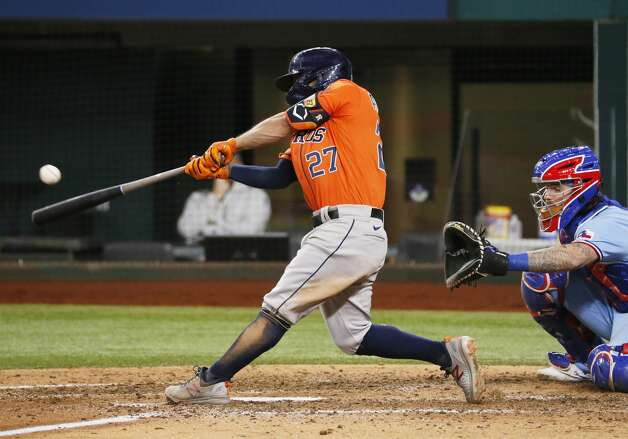Houston Astros' Jose Altuve hits a single against the Texas Rangers during the seventh inning of a baseball game in Arlington, Texas, Sunday, May 23, 2021. (AP Photo/Ray Carlin) Photo: Ray Carlin/Associated Press / Copyright 2021 The Associated Press. All rights reserved.