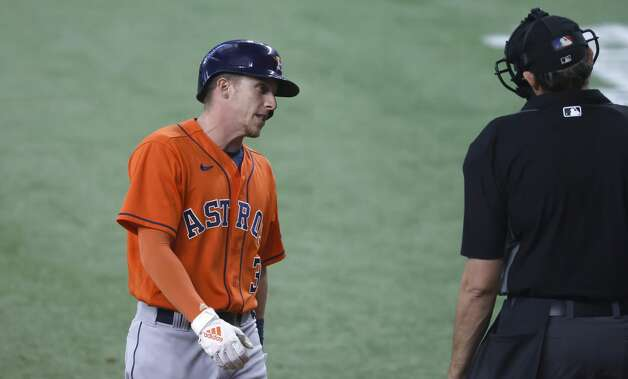 ARLINGTON, TX - MAY 23: Myles Straw #3 of the Houston Astros talks with umpire Ryan Additon #67 after striking out during the seventh inning at Globe Life Field on May 23, 2021 in Arlington, Texas. (Photo by Ron Jenkins/Getty Images) Photo: Ron Jenkins/Getty Images / 2021 Getty Images