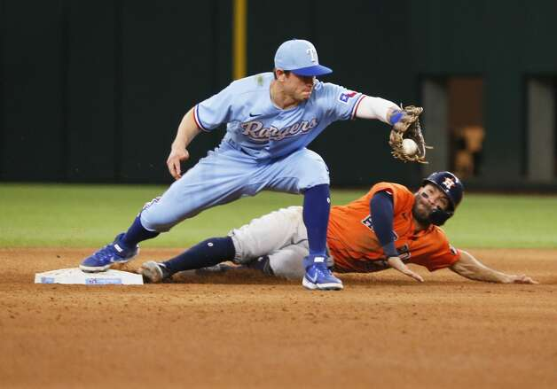 Texas Rangers second baseman Nick Solak, left, forces out Houston Astros' Jose Altuve, right, at second base during the sixth inning of a baseball game in Arlington, Texas, Sunday, May 23, 2021. (AP Photo/Ray Carlin) Photo: Ray Carlin/Associated Press / Copyright 2021 The Associated Press. All rights reserved.
