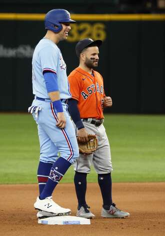 Texas Rangers' Nate Lowe, left, chats with Houston Astros second baseman Jose Altuve, right, while standing on second base during the fourth inning of a baseball game in Arlington, Texas, Sunday, May 23, 2021. (AP Photo/Ray Carlin) Photo: Ray Carlin/Associated Press / Copyright 2021 The Associated Press. All rights reserved.