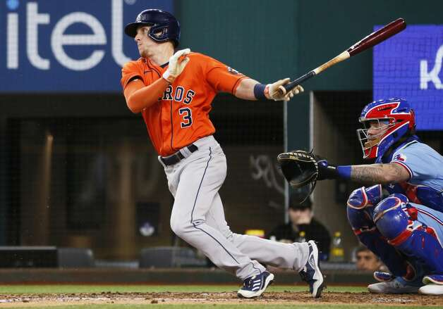 Houston Astros' Myles Straw follows through on an infield single against the Texas Rangers during the fifth inning of a baseball game in Arlington, Texas, Sunday, May 23, 2021. (AP Photo/Ray Carlin) Photo: Ray Carlin/Associated Press / Copyright 2021 The Associated Press. All rights reserved.