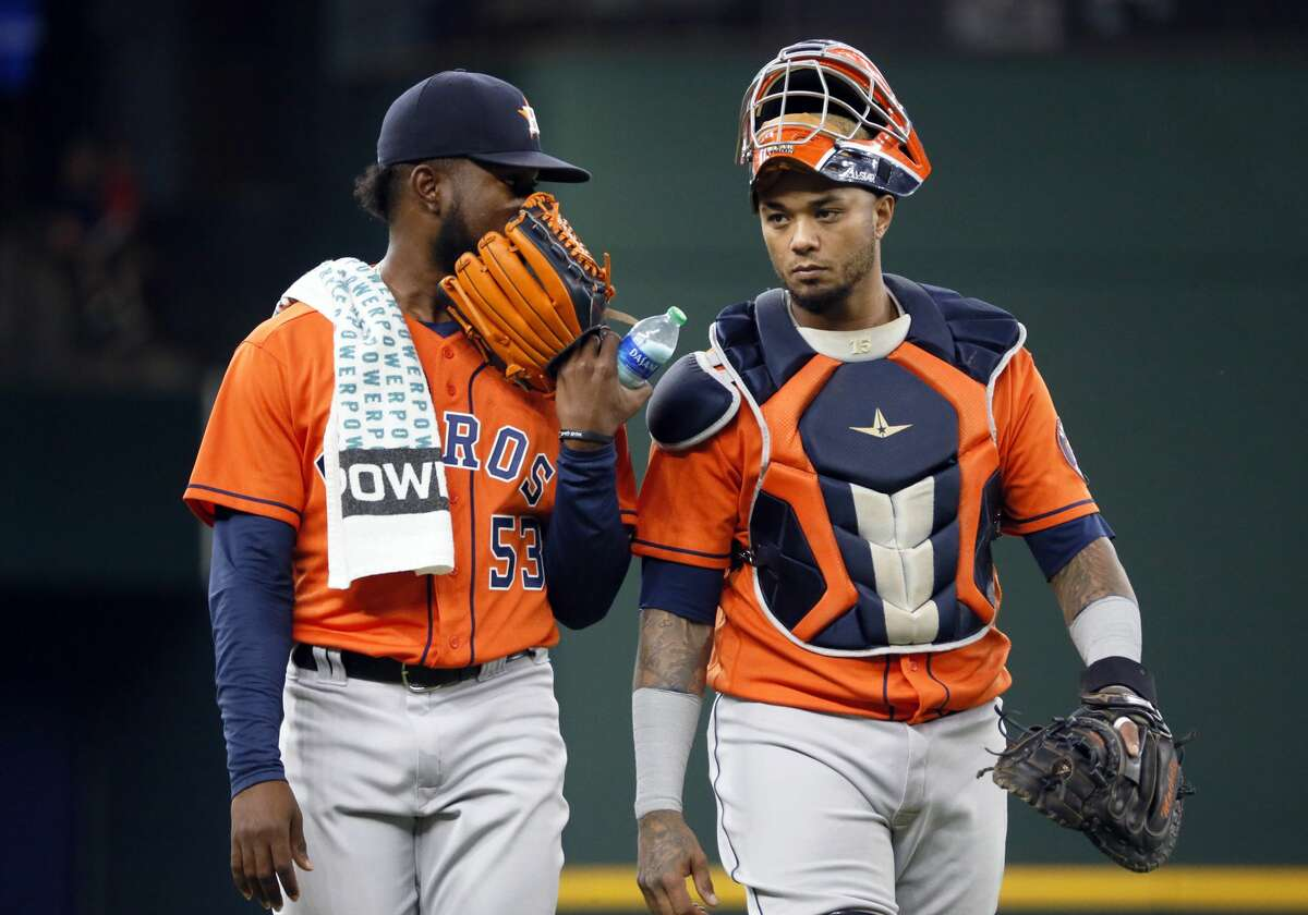 Houston Astros starting pitcher Cristian Javier, left, and catcher Martin Maldonado, right, walk in from the bullpen prior to a baseball game against the Texas Rangers in Arlington, Texas, Sunday, May 23, 2021. (AP Photo/Ray Carlin)