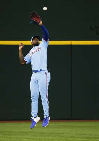 Texas Rangers center fielder Adolis Garcia makes the jumping catch of a fly ball by Houston Astros' Michael Brantley during the tenth inning of a baseball game in Arlington, Texas, Sunday, May 23, 2021. (AP Photo/Ray Carlin) Photo: Ray Carlin/Associated Press / Copyright 2021 The Associated Press. All rights reserved.