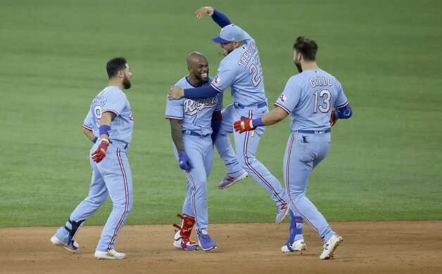 ARLINGTON, TX - MAY 23: Adolis Garcia #53 of the Texas Rangers and teammates Jose Trevino #23, Isiah Kiner-Falefa #9 and Joey Gallo #13 celebrate Garcia's game winning walk-off RBI single against the Houston Astros at Globe Life Field on May 23, 2021 in Arlington, Texas. The Rangers won 3-2. (Photo by Ron Jenkins/Getty Images) Photo: Ron Jenkins/Getty Images / 2021 Getty Images