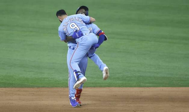 ARLINGTON, TX - MAY 23: Adolis Garcia #53 of the Texas Rangers and teammate Isiah Kiner-Falefa #9 celebrate Garcia's game winning walk-off RBI single against the Houston Astros at Globe Life Field on May 23, 2021 in Arlington, Texas. The Texas Rangers won 3-2. (Photo by Ron Jenkins/Getty Images) Photo: Ron Jenkins/Getty Images / 2021 Getty Images