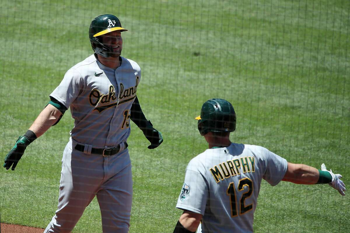 ANAHEIM, CALIFORNIA - MAY 23: Seth Brown #15 of the Oakland Athletics celebrates his two-run home run with Sean Murphy #12 during the second inning against the Los Angeles Angels at Angel Stadium of Anaheim on May 23, 2021 in Anaheim, California. (Photo by Katelyn Mulcahy/Getty Images)