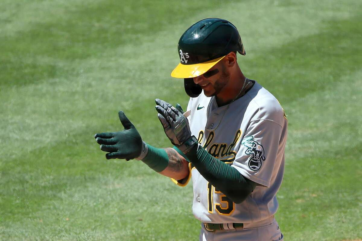 ANAHEIM, CALIFORNIA - MAY 23: Luis Barrera #13 of the Oakland Athletics celebrates his single during the fourth inning against the Los Angeles Angels at Angel Stadium of Anaheim on May 23, 2021 in Anaheim, California. (Photo by Katelyn Mulcahy/Getty Images)