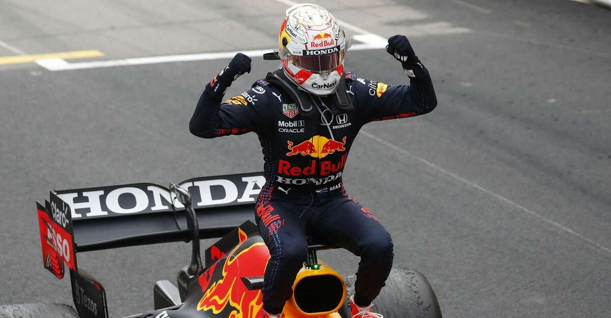 Winner Red Bull's Dutch driver Max Verstappen celebrates after the Monaco Formula 1 Grand Prix at the Monaco street circuit in Monaco, on May 23, 2021. (Photo by GONZALO FUENTES / POOL / AFP) (Photo by GONZALO FUENTES/POOL/AFP via Getty Images)