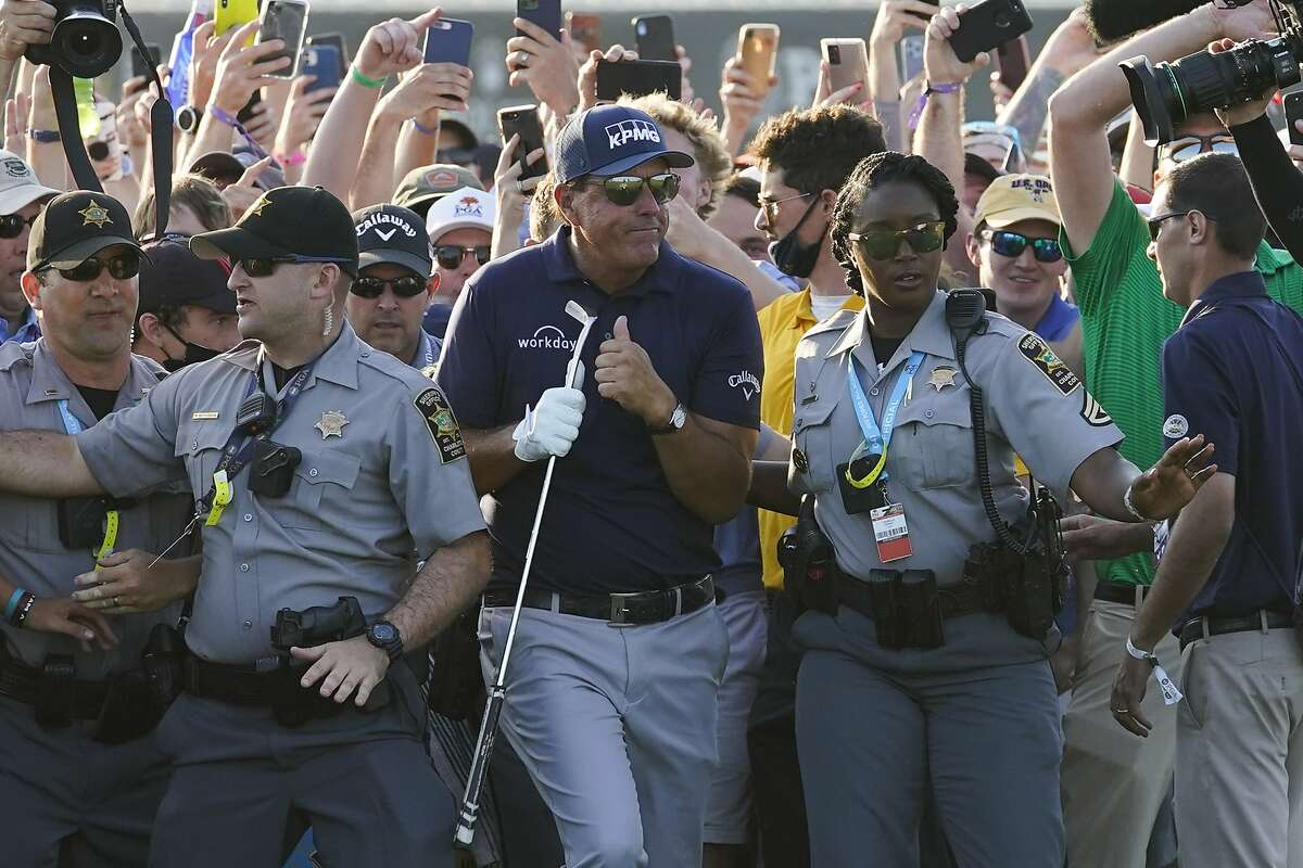 Phil Mickelson makes his way through fans on the 18th fairway during the final round at the PGA Championship on the Ocean Course at Kiawah Island, S.C. Mickelson won by two strokes.