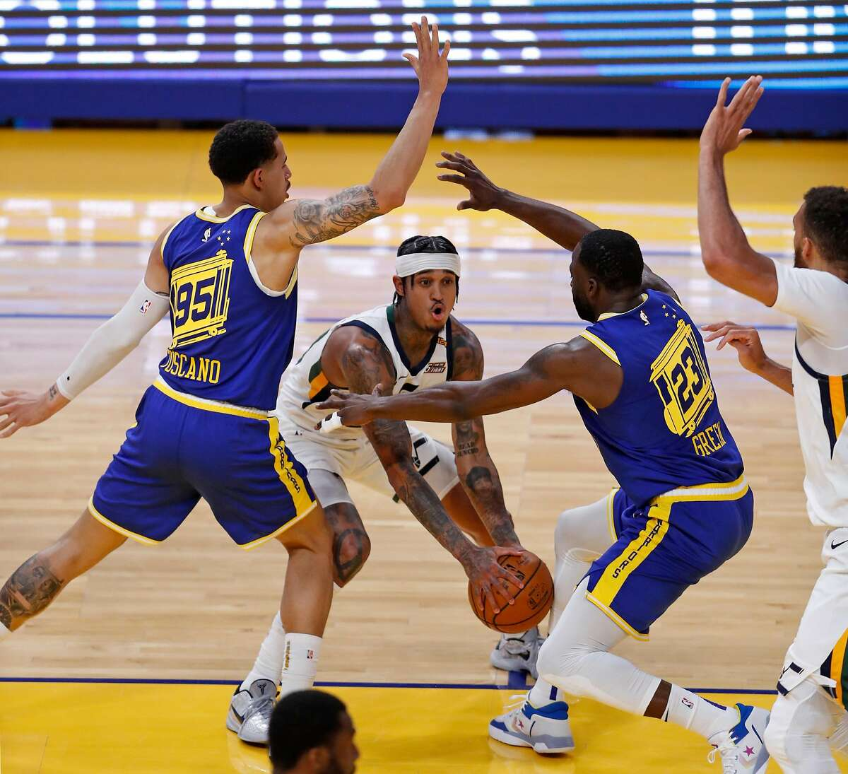 Golden State Warriors' Juan Toscano-Anderson and Draymond Green double team Utah Jazz' Jordan Clarkson during 2nd quarter of NBA game at Chase Center in San Francisco, Calif., on Monday, May 10, 2021.