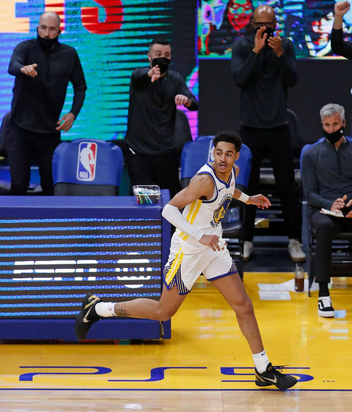 Golden State Warriors' Jordan Poole heads up court after hitting a 3-pointer against Memphis Grizzlies in 3rd quarter during NBA game at Chase Center in San Francisco, Calif., on Sunday, May 16, 2021.