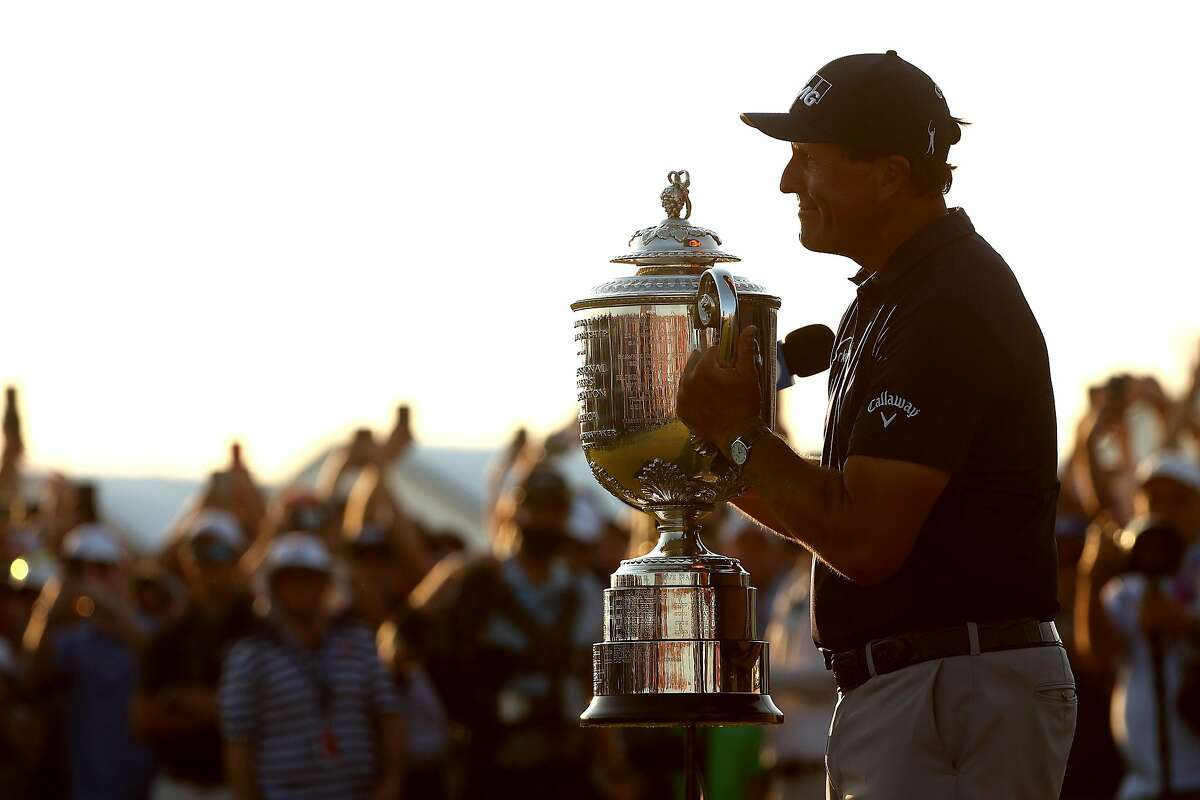 Phil Mickelson celebrates with the Wanamaker Trophy after winning the 2021 PGA Championship at Kiawah Island, S.C.