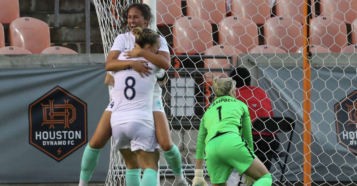 Houston Dash goalkeeper Jane Campbell (1) lays on the ground after Kansas City defender Taylor Leach (24) scored a goal during the second half of an NWSL match Sunday, May 23, 2021, at BBVA Stadium in Houston.