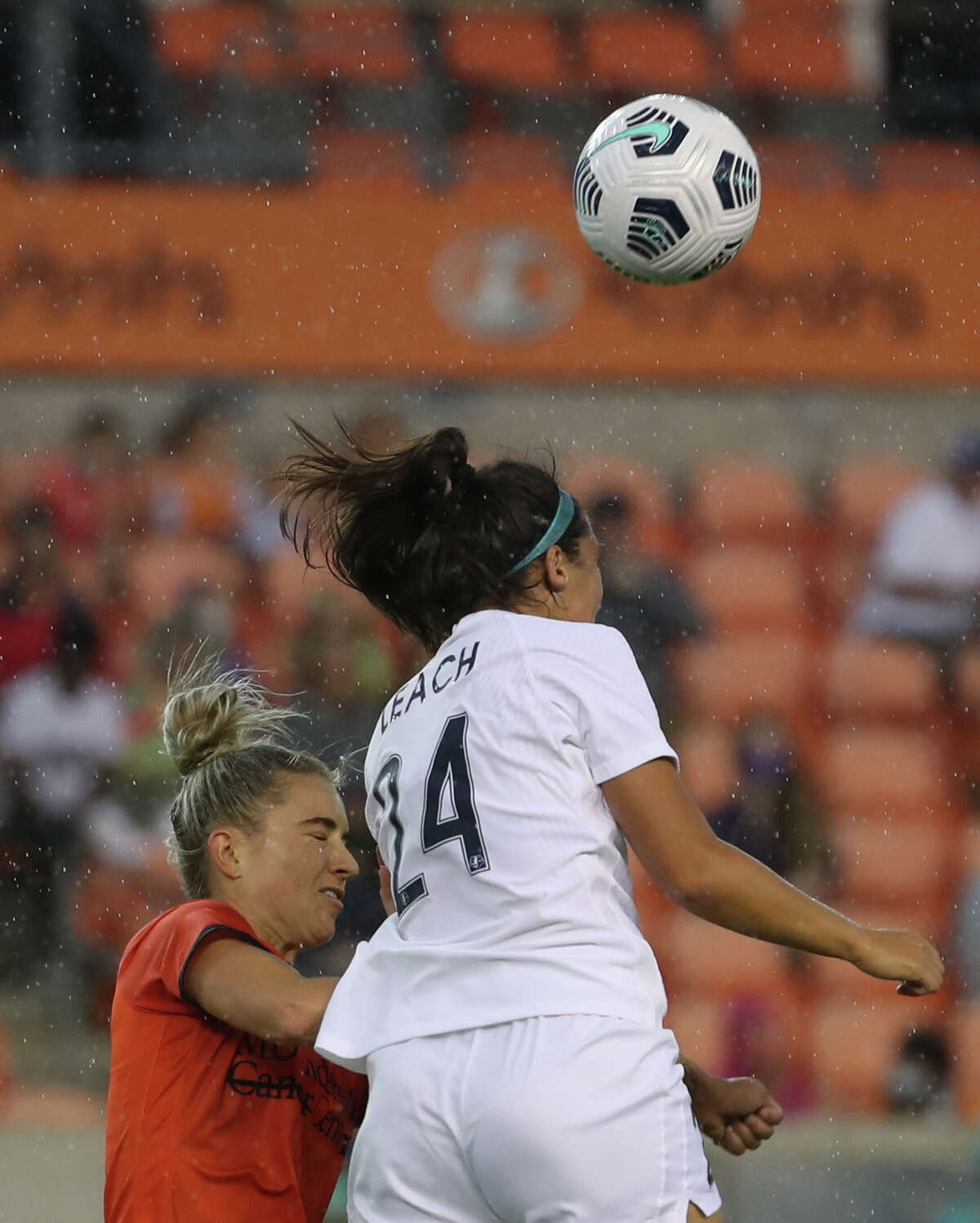 Houston Dash midfielder Kristie Mewis (19) and Kansas City defender Taylor Leach (24) battle for control of the ball during the first half of an NWSL match Sunday, May 23, 2021, at BBVA Stadium in Houston.