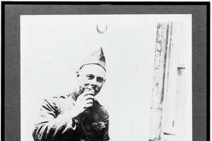 A Doughboy eating doughnuts circa World War I.