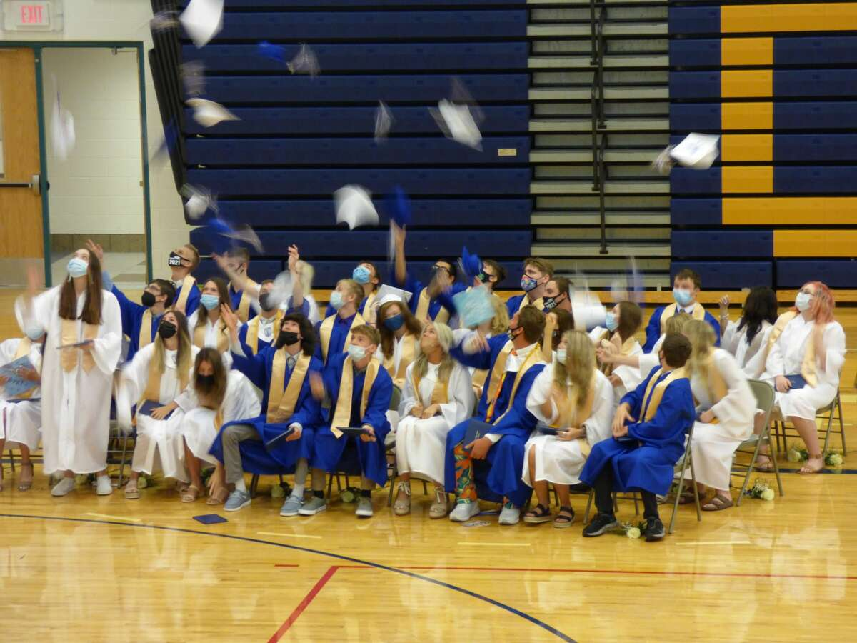 Onekama High School graduates toss their caps to close out the 2021 commencement ceremony.