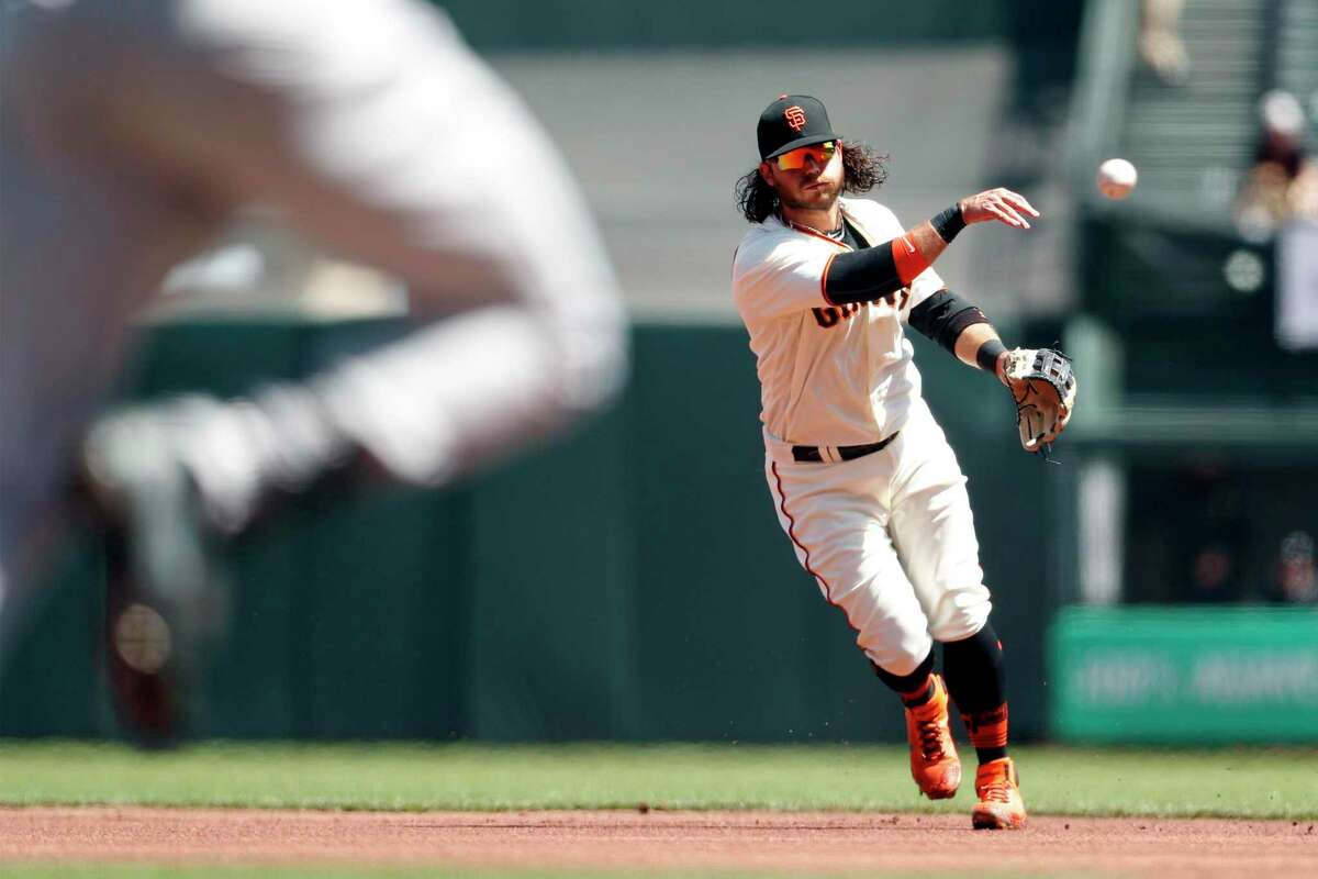 Brandon Crawford throws out Charlie Blackmon to end top of first inning on April 11 at Oracle Park.