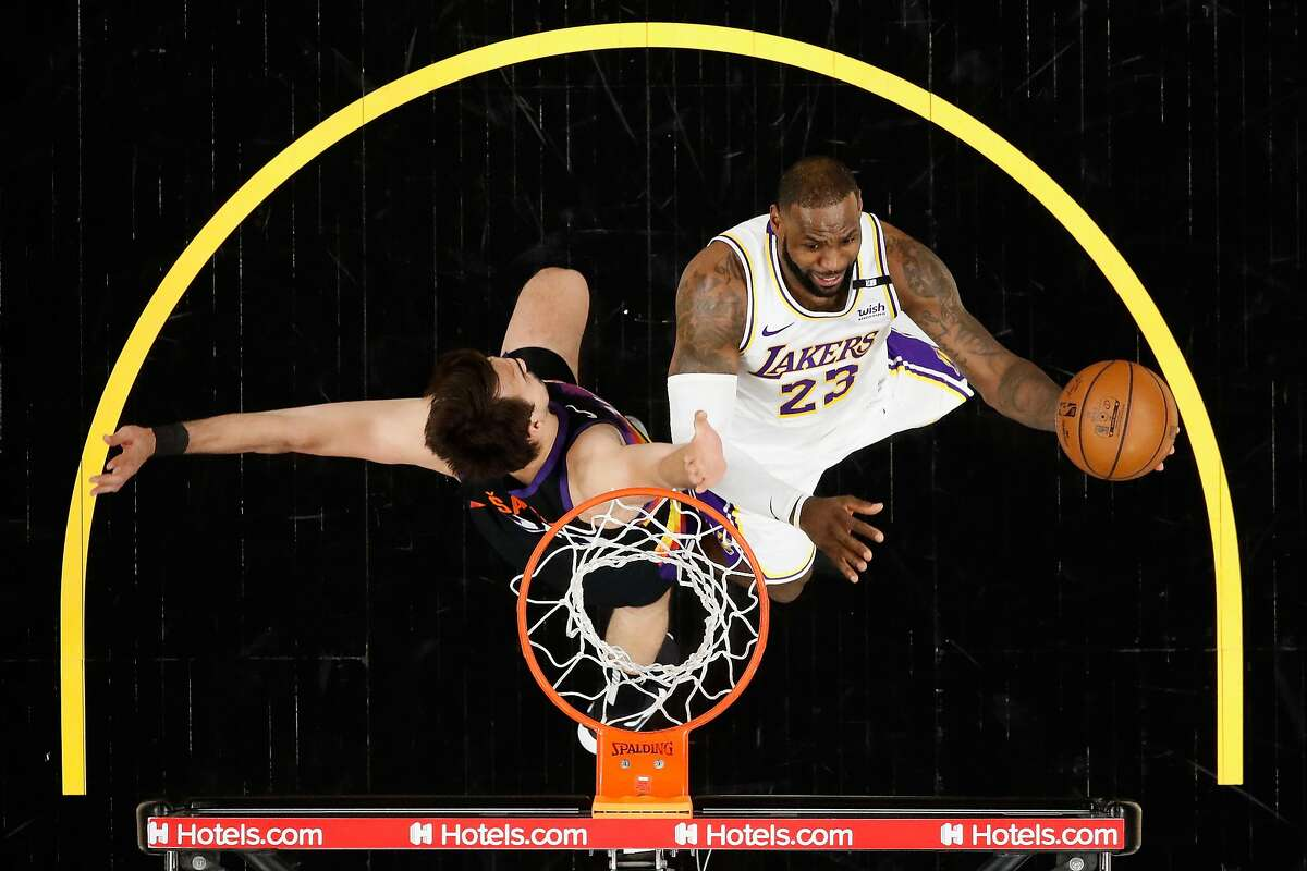 LeBron James, right, and the Lakers visit Dario Saric and the Suns in Game 2 of their first-round series at 7 p.m. Tuesday (TNT).