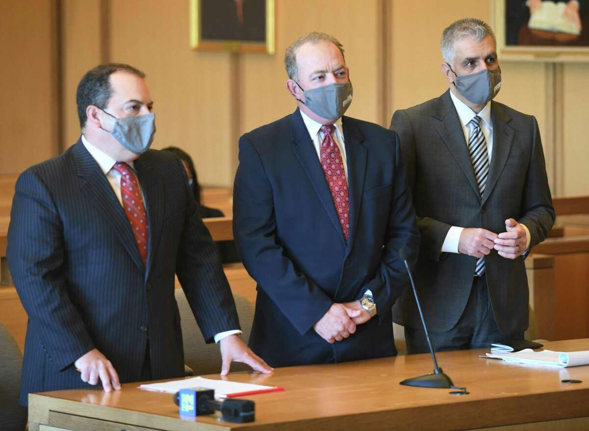 Kent Mawhinney, center, the longtime lawyer and friend of Fotis Dulos, appears in court with his lawyers Lee Gold, left, and Jeffrey Kestenband at the Connecticut Superior Court in Stamford, Conn. Tuesday, May 18, 2021. Mawhinney has pleaded not guilty to conspiracy to commit murder in the May 2019 death and disappearance of New Canaan mother-of-five Jennifer Dulos. Mawhinney and his lawyers appeared in court Tuesday asking for the removal of his GPS tracking device so that Mawhinney could put on skates and referee hockey games, which the judge denied.